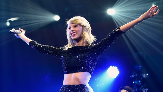 Singer Taylor Swift performs onstage during KIIS FM's Jingle Ball 2014  powered by LINE at Staples Center on December 5, 2014 in Los Angeles, California.
