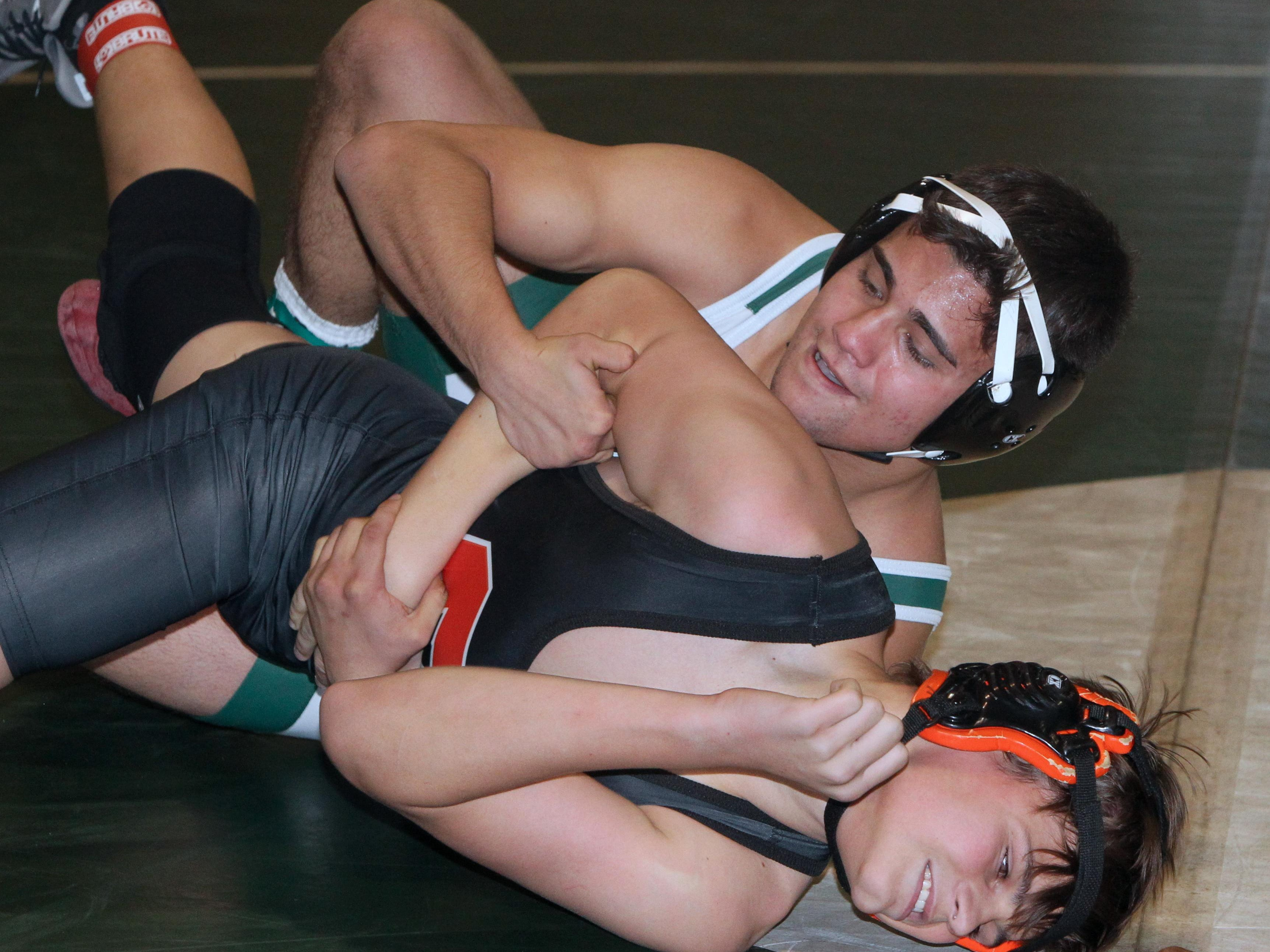 Pleasantville's Lou Quintanilla, top, pinned Croton's Brendan Stierli in the 160-pound final at the Section 1 Dual Meet Championships Division 2 quad meet at Irvington Dec. 1, 2015.