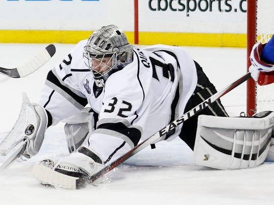 Los Angeles Kings goalie Jonathan Quick (32) blocks a shot against the New York Rangers in the second period during Game 3 of the NHL hockey Stanley Cup Final, Monday, June 9, 2014, in New York. (AP Photo/Kathy Willens)