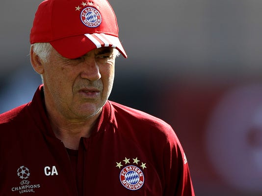 Bayern head coach Carlo Ancelotti watches his team during a training session prior to the Champions League Group D soccer match between FC Bayern Munich and FK Rostov in Munich, Germany, Monday, Sept. 12, 2016. Bayern will face Rostov on Tuesday. (AP Photo/Matthias Schrader)