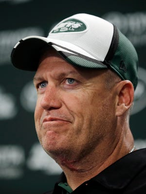 File- In this June 17, 2014, file photo, New York Jets head coach Rex Ryan listens to a question during a news conference after a workout at NFL football minicamp in Florham Park, N.J. A person familiar with discussions tells The Associated Press that Ryan has agreed to coach the Buffalo Bills. The person said the agreement was reached Sunday, Jan. 11, 2015, after the Bills extended the offer to the former Jets coach and he accepted. (AP Photo/Mel Evans, File)