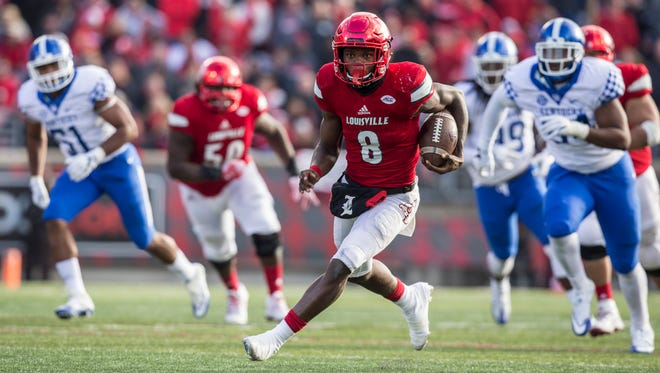 U of L's Lamar Jackson breaks free on a run during the fourth quarter of a 41-38 Cats victory over U of L at Papa John's Cardinal Stadium on Saturday. Nov. 26, 2016