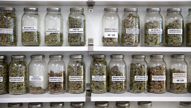 Mason jars with loose marijuana flowers are seen at the Sunset Herbal Corner in Los Angeles, California on Monday, April 16, 2018.
