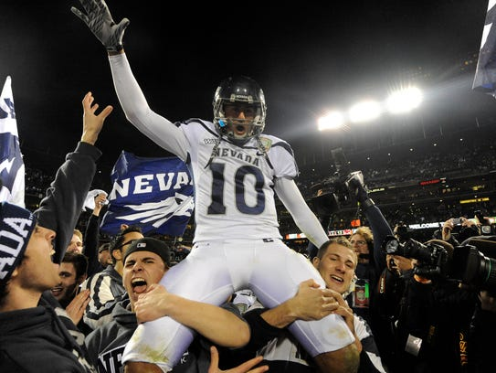 Fans carry Colin Kaepernick after Nevada's 2010 win