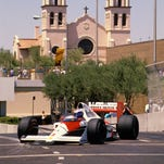 THEN: For three years, Formula One racing took to the streets of downtown Phoenix for the Phoenix Grand Prix. The first race was June 4, 1989. Alain Prost (shown here driving his McClaren-Honda) won that race. To avoid the heat, the race was held in March in 1990 and 1991. Ayrton Senna won both those races. This photo was shot from Third Street, which at the time went under the Phoenix Convention Center.