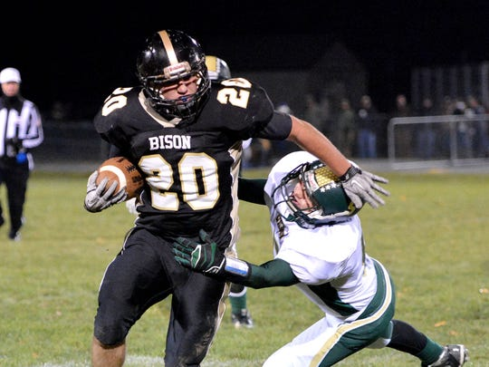 Buffalo Gap's Austin Perry has the ball as he breaks free of a tackle attempt by Wilson Memorial's Austin Poff during a football game played in Swoope on Friday, Nov. 8, 2013.