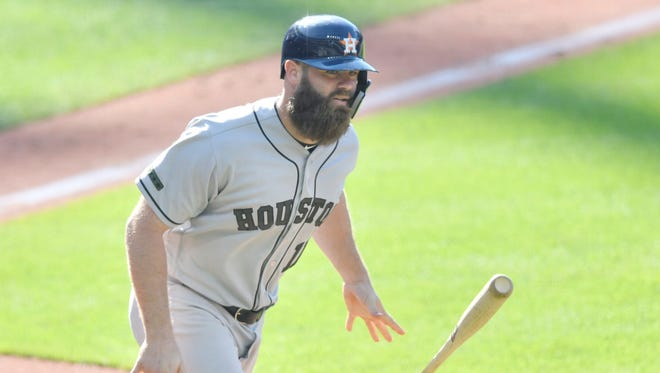 Astros designated hitter Evan Gattis tosses his bat after hitting a solo home run against the Indians.