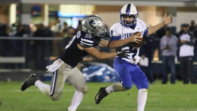 Zanesville's Ben Everson is chased by a Granville defender during their 2017 game in Granville. The Blue Devils and Blue Aces will become regular competitors when Zanesville joins the Licking County League in 2020-21.