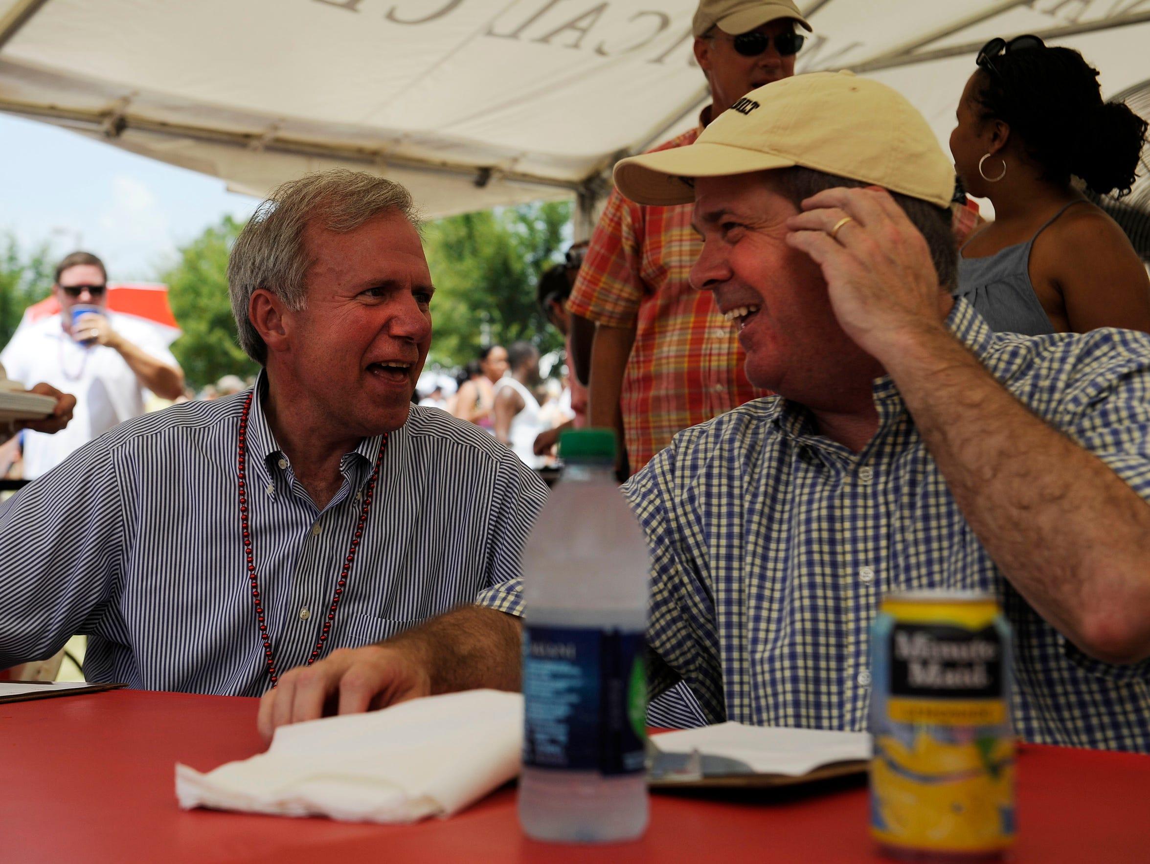 Former Nashville Mayor Bill Purcell, left, laughs with