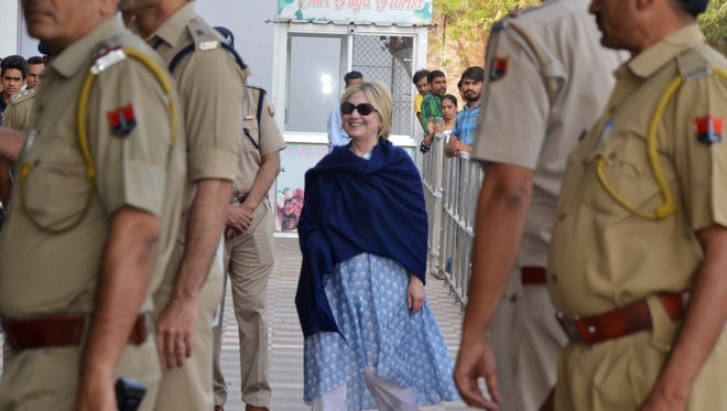 In this Thursday, March 15, 2018 photo, former Secretary of State Hillary Clinton arrives at the Jodhpur airport to take a flight to Jaipur in Jodhpur, Rajasthan state, India.