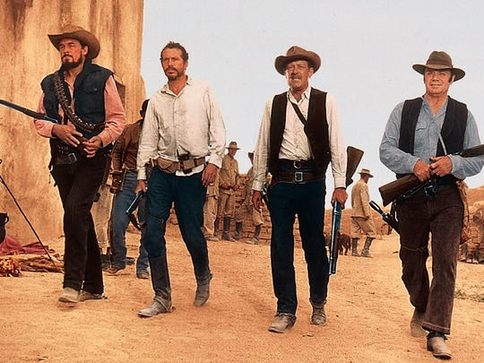 Ben Johnson Warren Oates William Holden and Ernest Borgnine in 'The Wild Bunch'---1969 Warner Brothers publicity photo.