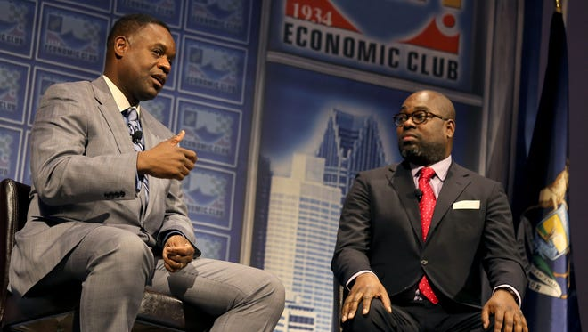 Kevyn Orr answers questions from Stephen Henderson, Detroit Free Press Managing Editor/Opinion and Community Engagement during a Detroit Economic Club Luncheon at Cobo Center in Detroit on Tuesday.