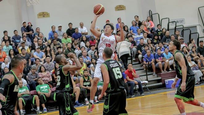 In this file photo, Kenneth Duremdes of the Philippine Basketball Association Legends takes a jumper against the Filipino Sports Association of Guam All-Stars at the Phoenix Center.