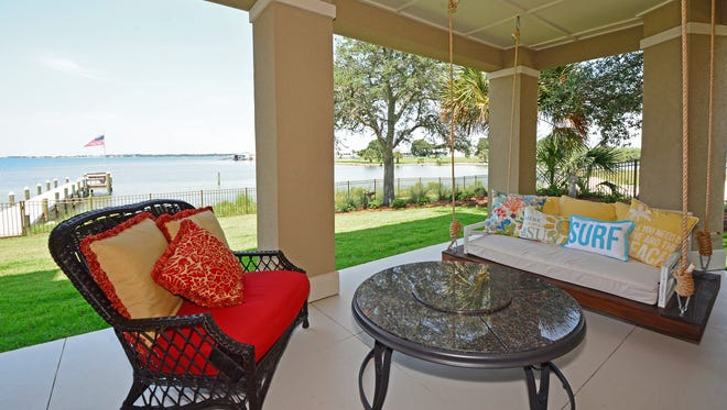 A relaxing space on the back deck is one of the Antouns' favorite areas on the property.