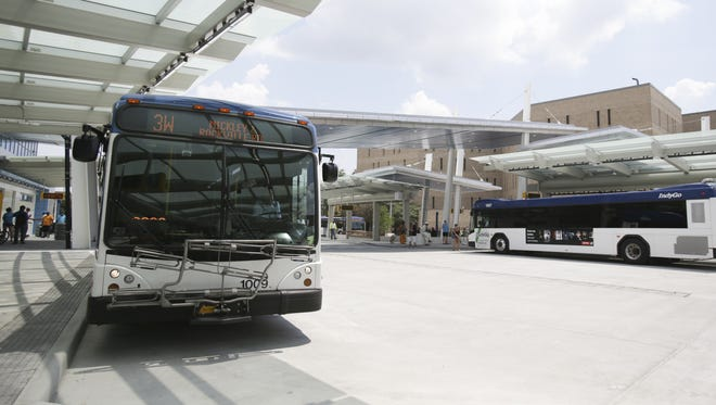 Buses await passengers at the new Julia M. Carson Transit Center in Downtown Indianapolis on Sunday.