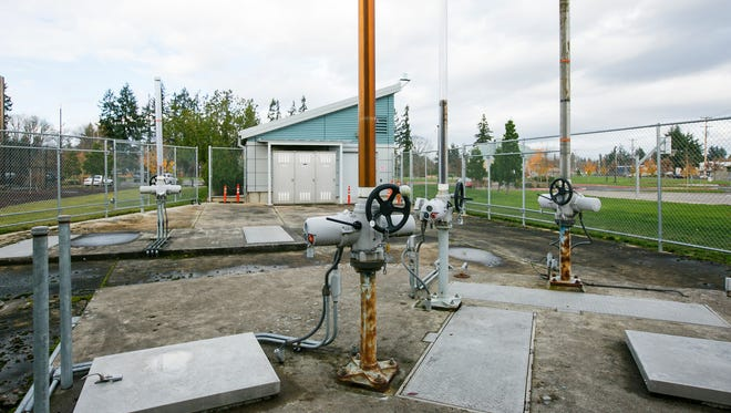 Valves that direct water either to a treatment facility or straight to the Willamette River are seen at River Road Park in Salem on Monday, Nov. 28, 2016. The city of Salem released more than 22 million gallons of diluted raw sewage into the Willamette River Thanksgiving afternoon and the following morning after heavy rain overwhelmed its sewer system.