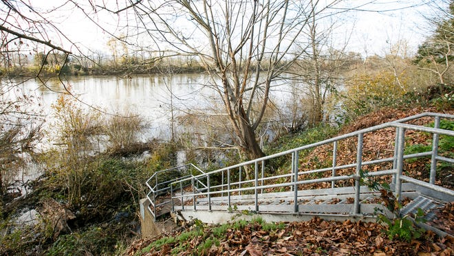 Stairs lead down to a gate that lets water flow into the Willamette from the North River Road diversion structure at River Road Park.