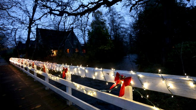 The pedestrian bridge over Mill Creek is decorated with lights near Court St. NE in Salem on Friday, Dec. 2, 2016. The bridge will torn down and replaced next summer.