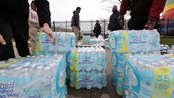 Flint/Genesee County Job Corps Center students gather cases of water to distribute at the school to those in need during the Flint water crisis on Wednesday March 30, 2016, at the Flint/Genesee County Job Corps Center.