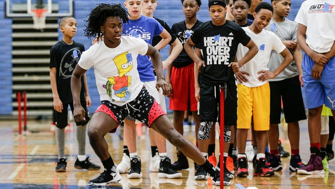 Javaughn Hannah of Mount Clemens shows his movement at a lane agility drill test during Bates Fundamentals Basketball Training at Lincoln High School in Augusta Township, Saturday, February 17, 2018.