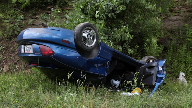 A car lay on its roof after a roll-over accident on Northpointe near Dresden on Friday.