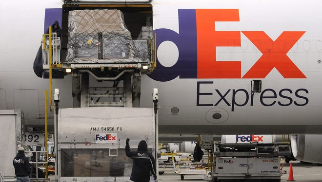 FedEx is crediting the tax cuts for its plans to invest $1.5 billion into its Indianapolis shipping hub, the company announced Friday.