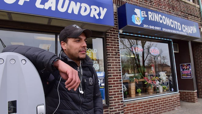 Nick Rivera trying to pick up day work in Palisades Park on Tuesday. Rivera said jokingly that he does not wear work boots in case he has to run from immigration officials. Rivera came to the U.S. as a 7-year-old from Uruguay.