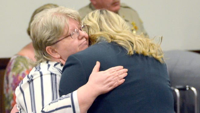Vonda Star Smith, left, is hugged by defense lawyer Lesley A. Tiller after a Greene County Criminal Court jury Friday found her guilty of one count each of first-degree murder and second-degree murder for the August 2016 death of 21-year-old Jessie Nicole Morrison and her unborn child. (Ken Little / Greeneville Sun)