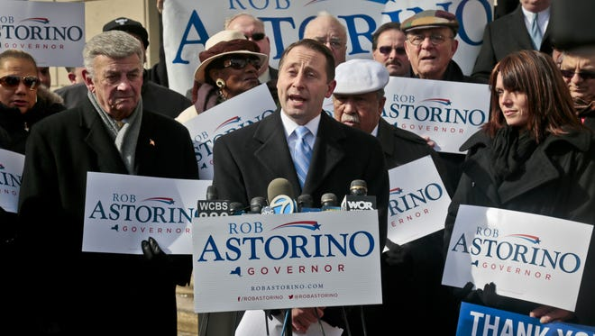 Surrounded by supporters and joined by his wife Sheila Astorino, second from right, New York state gubernatorial candidate Rob Astorino, center, kicks off his campaign for the governor's race. Astorino is highly critical of Gov. Cuomo's tax-rebate proposal.