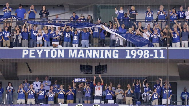 Former Colts quarterback Peyton Manning has his name added to the ring of honor and jersey retired during the halftime festivities of their game against the San Francisco 49ers at Lucas Oil Stadium, Oct 8, 2017.