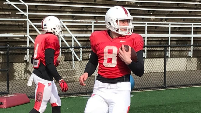 Ball State basketball player Tayler Persons goes through drills with the football team as part of an April Fools joke.