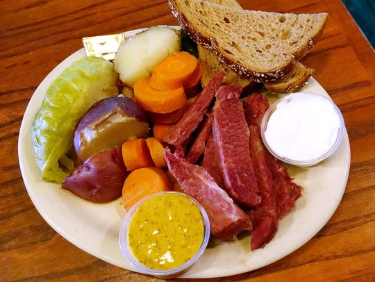 Corned beef and cabbage with potatoes, rye bread, horseradish