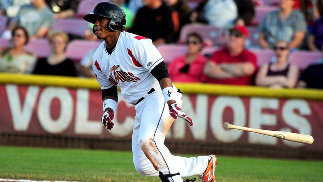 Volcanoes third baseman Miguel Gomez watches the ball off his bat against Vancouver at Volcanoes Stadium, on Friday, June 19, 2015, in Keizer.