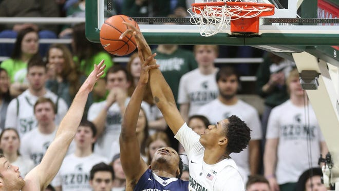 Michigan State Spartans Deyonta Davis blocks a shot by the Penn State Nittany Lions Brandon Taylor during first half action on Sunday, Febuary 28, 2016 at the Breslin Center in East Lansing, MI.