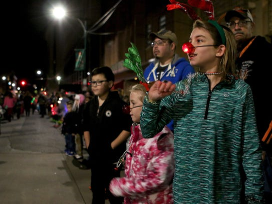 Campbell Hansard (right) and Cooper Hansard wave to participants in the City Lights Parade in downtown Wichita Falls in November 2017.