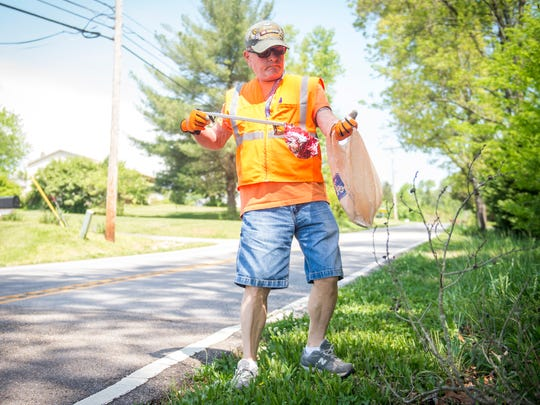 Vietnam veteran Lou Volk picks up trash along Bob Kirby Road in West Knoxville on Wednesday, May 2, 2018. Volk has walked up and down Bob Kirby Road for 12 years picking up trash.