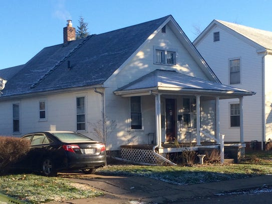 Crime scene tape surrounds a house at 525 Laurel St.