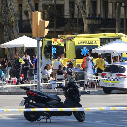 Injured people are treated in Barcelona, Spain, Thursday,
