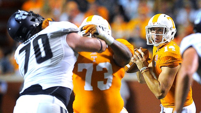 Vols offensive lineman Jashon Robertson (73) blocks for quarterback Justin Worley (14) in a game against Utah State at Neyland Stadium on Aug. 31, 2014.