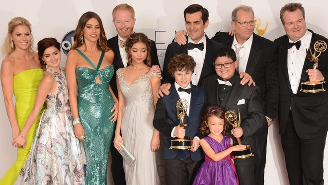 """The cast of Modern Family poses at the 64th annual Prime Time Emmy Awards on September 23, 2012. ABC's """"Modern Family,"""" the five-time Emmy Award winner for best comedy, will end its run next year after 11 seasons. ABC Entertainment President Karey Burke announced the end of the series about the boisterous extended family on Tuesday."""