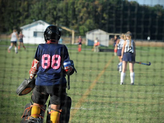 Holly Grove goalkeeper Aron Lankford watches her team