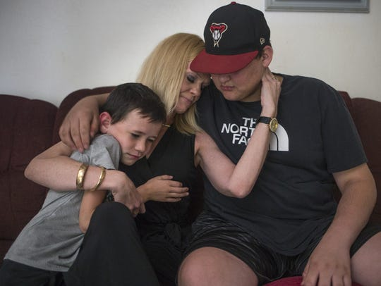 Jessica Ballandby embraces her sons,  6-year-old Jonathan