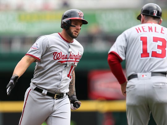 Washington Nationals first baseman Matt Adams (15) rounds the bases after hitting a three-run home run in the first inning during the National League baseball game between the Washington Nationals and the Cincinnati Reds, Saturday, March 31, 2018, at Great American Ball Park in Cincinnati.
