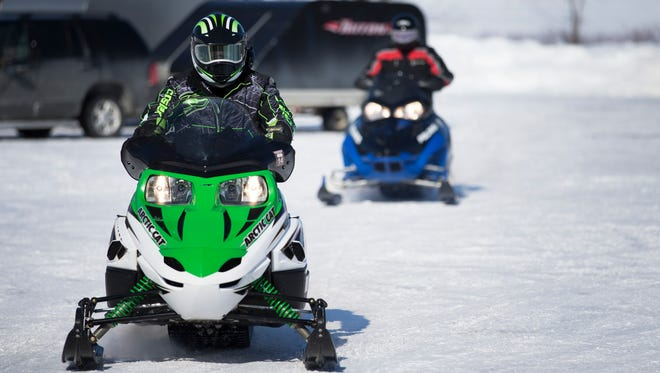 Mark Boff and Marc Wiggins of Ogden head out to a snowmobiling trail at Churchville Park in 2015.