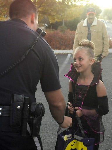 Skylar Fitts, 8, gathers candy from a Nevada Highway