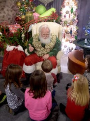 Santa Claus answers kids' questions at the Every Day