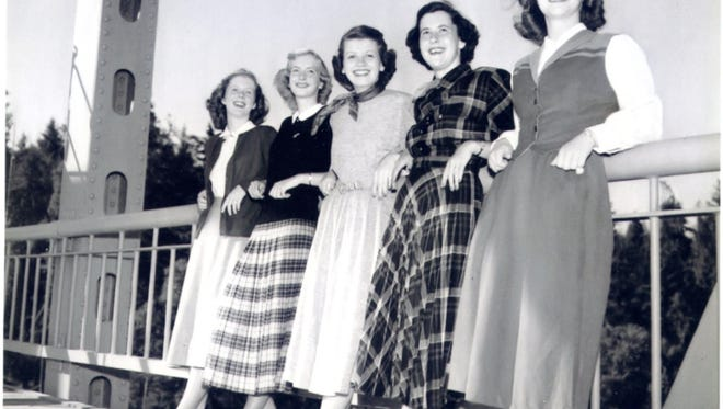 In 1948, the Fashion Board for the Bremerton Sun newspaper poses on the old Manette Bridge.  In the center is Gerry Peret. Please contact the Kitsap History Museum if you recognize any of the other Fashion Board members. To see more photos from the Kitsap County Historical Society Museum archives, visit facebook.com/kitsaphistory, kitsapmuseum.org, or stop by the museum at 280 Fourth St. in Bremerton. Call 360-479-6226 for information.