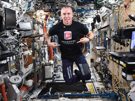 Purdue alum, astronaut Drew Feustel, wears an Andretti Autosport T-shirt while floating in the International Space Station. Feustel, amid a six-month mission, has been taking incredible photos of race tracks from 250 miles away.