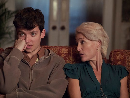 Asa Butterfield as Otis and Gillian Anderson as Jean