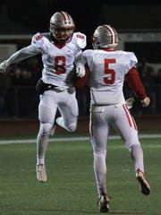 Shelby tailback Shorty Brooks (8) and quarterback Brennan Armstrong (5) celebrate a first half touchdown in regional championship win over Bellevue.